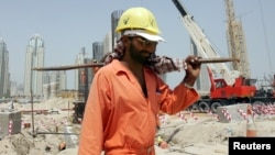 FILE - A worker toils in the heat at a construction site in Dubai, where temperatures can hit 45 degrees C.