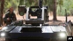 "Israel Aerospace Industries' semi-autonomous four-wheel-drive ""REX MKII"" is seen at an IAI facility near the central Israeli city of Lod, Thursday, Sept. 9, 2021. (AP Photo/Sebastian Scheiner)"