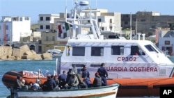 An Italian Coast Guard boat approaches a boat of refugees off Lampedusa, March 2, 2011 (file photo).