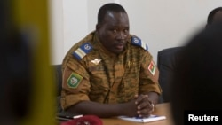 FILE - Lieutenant Colonel Isaac Zida meets with opposition leaders in Ouagadougou, capital of Burkina Faso, Nov. 2, 2014.