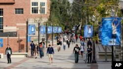 FILE - Students walk on the UCLA campus in Los Angeles, Feb. 26, 2015.