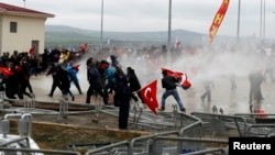 Security forces use water cannons to disperse protesters outside a courthouse where a hearing on people charged with attempting to overthrow Prime Minister Tayyip Erdogan's Islamist-rooted government is due to take place, in Silivri, Turkey, April 8, 2013.