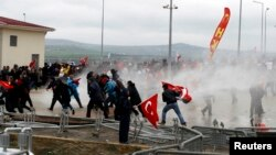 Security forces use water cannons to disperse protesters outside a courthouse in Silivri, where a hearing on people charged with attempting to overthrow Prime Minister Tayyip Erdogan's Islamist-rooted government is due to take place, Apr. 8, 2013.