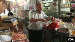 Damascus has been somewhat spared as the Syrian economy slows.
