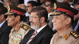 Egyptian Field Marshal Gen. Hussein Tantawi (l) President Mohammed Morsi, center, and Armed Forces Chief of Staff Sami Anan, right, July 5, 2012.