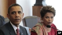 U.S. President Barack Obama and Brazilian President Dilma Vana Rousseff, right, take part in the US-Brazil CEO Forum at the Palacio do Itamaraty in Brasilia, Brazil, Saturday, March 19, 2011.