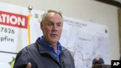 FILE - Ryan Zinke, U.S. interior secretary, responds to a reporter's question during a news conference after touring the fire-ravaged town of Paradise, Calif., Nov. 14, 2018.