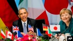 奥巴马和默克尔出席在海牙举行的G7领导人会议 (资料照)