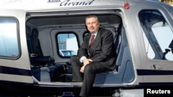 FILE - Finmeccanica Chairman and Chief Executive Officer Giuseppe Orsi poses in a helicopter during the opening ceremony of the new Terminal of Vertiporto dell'Urbe in Rome on January 19, 2009.