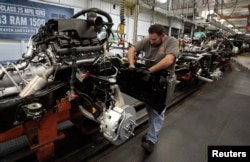 Chrysler assembly staff works on the chassis of a 2014 Dodge Ram pickup truck at the Warren Assembly Plant in Warren, Michigan December 11, 2013. Chrysler Group LLC, which is owned by Fiat SpA, on January 29, 2014, said its revenue would rise 11 percent t