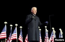 Democratic U.S. presidential nominee and former Vice President Joe Biden smiles during a drive-in campaign rally at Heinz Field in Pittsburgh, Pennsylvania, U.S., November 2, 2020. REUTERS/Kevin Lamarque