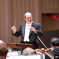 Robert Spano conducts the world premiere of Christoper Theofanides' 'Une Certaine Joie de Vivre' at the Atlanta Symphony's season opening night concert in September 2010.