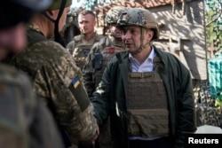 Ukraine's President Volodymyr Zelenskiy visits positions of armed forces in Donetsk region, Ukraine, Oct. 14, 2019.
