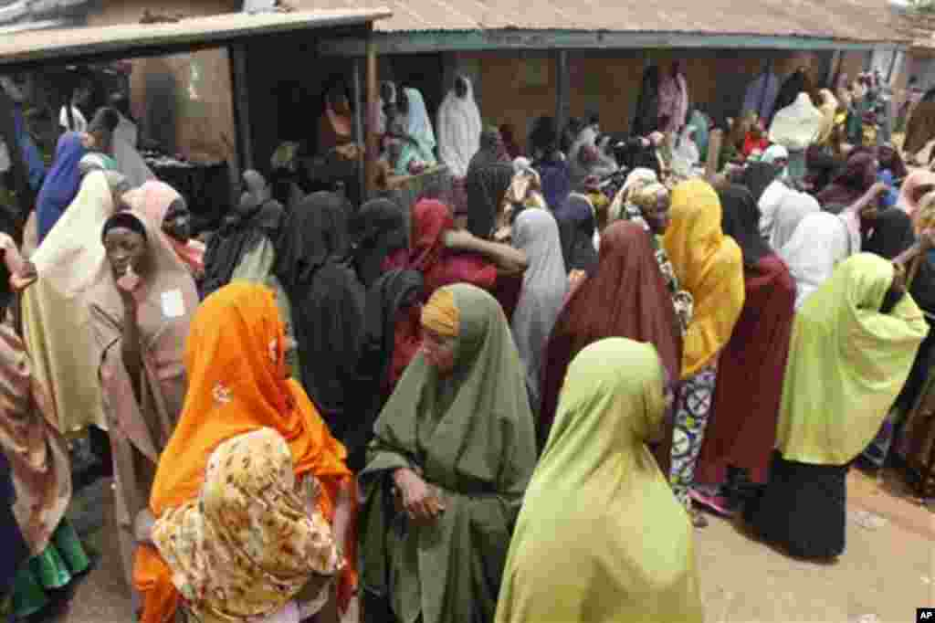 Women gather as the wait to cast their votes in Kaduna, Nigeria, Thursday, April 28, 2011. Two states in Nigeria's Muslim north voted Thursday for state gubernatorial candidates after their polls were delayed by violence that killed at least 500 last wee