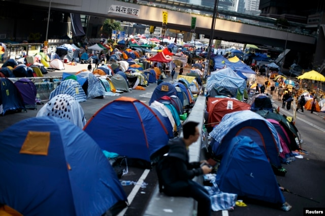 FILE - Protesters and tents occupy the main road to the financial district in Hong Kong, Dec. 9, 2014.