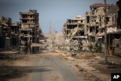 FILE - In this Oct. 22, 2011 file photo, a general view of buildings ravaged by fighting in Sirte, Libya.