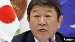 Japan's Economy Minister Toshimitsu Motegi says, Jan. 23, 2018, eleven countries aiming to forge an Asia-Pacific trade pact after the United States pulled out of an earlier version will sign an agreement in Chile in March.