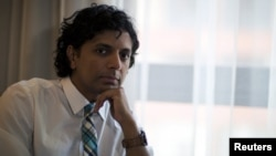 FILE - Director M. Night Shyamalan poses for portrait during the 2015 Comic-Con International Convention in San Diego, California, July 9, 2015.