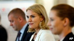 Denmark's Social Democrats, headed by Prime Minieter Helle Thorning-Schmidt, center, Minister of Finance Bjarke Corydon, left, and Minister of Justice Mette Frederiksen, attend press conference, Copenhagen, June 17, 2015.