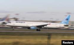 FILE - The Metrojet's Airbus A321 with registration number EI-ETJ that crashed in Egypt's Sinai Peninsula, takes off from Moscow's Domodedovo airport, Russia, Oct. 20, 2015.