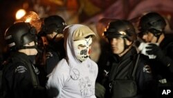 Police arrest an Occupy Los Angeles protester at the encampment at city hall November 30, 2011.