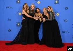 Laura Dern, from left, Nicole Kidman, Zoe Kravitz, Reese Witherspoon and Shailene Woodley in the press room with the award for best television limited series or motion picture made for television for 'Big Little Lies' at the 75th Golden Globe Awards.