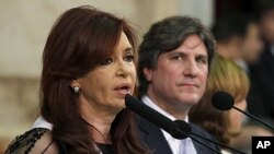 Argentina's President Cristina Fernandez de Kirchner speaks in Congress next to her new Vice President Amado Boudou after she was sworn in for her second mandate, in Buenos Aires, December 10, 2011.