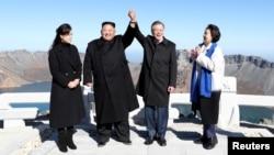 FILE - South Korean President Moon Jae-in and North Korean leader Kim Jong Un pose for photographs on the top of Mt. Paektu, North Korea, Sept. 20, 2018.