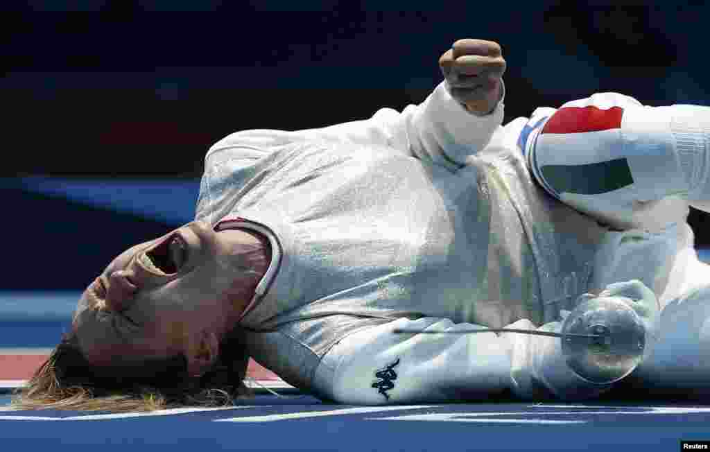 Italy's Valentina Vezzali celebrates defeating Tunisia's Ines Boubakri (not pictured) during their women's Individual Foil quarterfinal fencing competition at the ExCel venue at the London 2012 Olympic Games July 28, 2012.