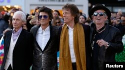 "Members of the Rolling Stones (L-R) Charlie Watts, Ronnie Wood, Mick Jagger and Keith Richards arrive for the ""Exhibitionism"" opening night gala at the Saatchi Gallery in London, April 4, 2016."