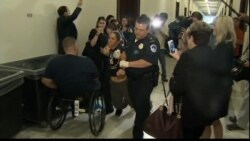Police Remove Health Care Protester
