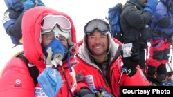 Yuichiro Miura and his son, Gota, summit at Mount Everest, May 22, 2003 (Miura Dolphins).
