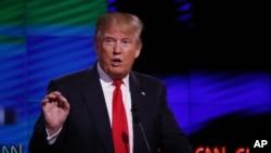 Kandidat Capres AS dari Partai Republik, Donald Trump dalam debat di University of Miami, Coral Gables, Florida (10/3).