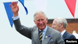 FILE - Britain's Prince Charles waves to the crowd during a visit to the harbour in Bridlington, northern England.