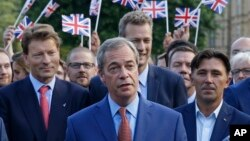 Nigel Farage, the leader of the UK Independence Party speaks to the media on College Green in London, June 24, 2016. (AP Photo/Matt Dunham)