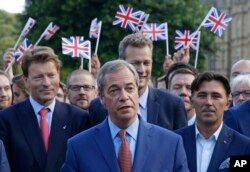 Nigel Farage, the leader of the UK Independence Party speaks to the media on College Green in London, June 24, 2016.