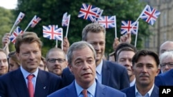 Nigel Farage, the leader of the UK Independence Party, speaks to the media on College Green in London, June 24, 2016.