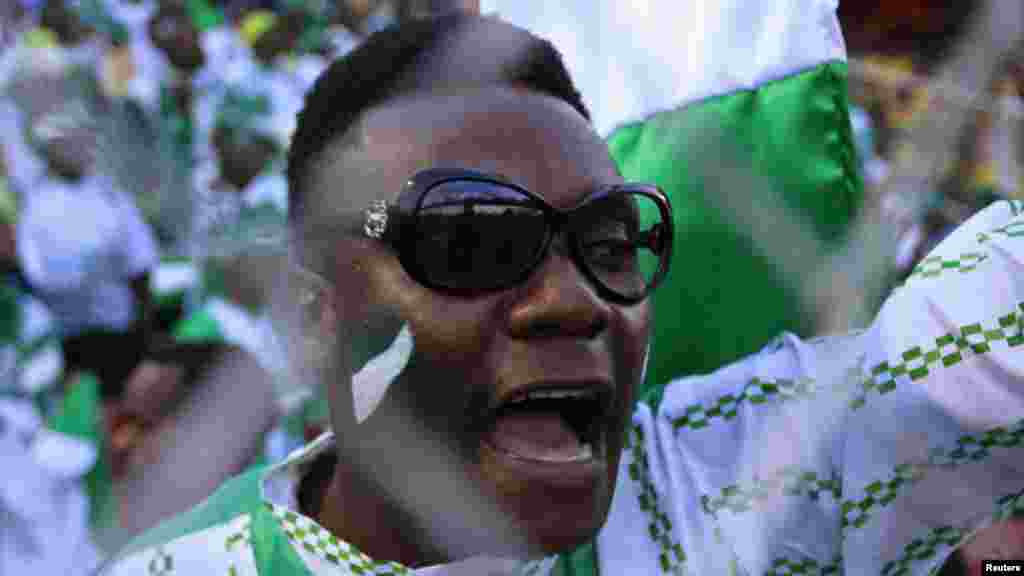 A supporter of Nigeria's football team celebrates their 2- 1 victory over Ethiopia in their 2014 World Cup qualifying soccer match.