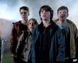 Left to right: Gabriel Basso plays Martin, Ryan Lee plays Cary, Joel Courtney plays Joe Lamb, and Riley Griffiths plays Charles in SUPER 8, from Paramount Pictures.