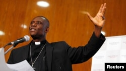 Umwepiskopi wa Angicane muri Nijeriya Josiah Idowu-Fearon avuga mu biganiro i Abuja, Nijeriya, itariki ya 22/01/2015.