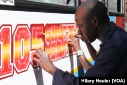 Until recently Kenya had banned any painting on Nairobi's 10,000 matatus other than a standard yellow stripe, Nairobi, Jan. 23, 2015. (Hilary Heuler/for VOA)