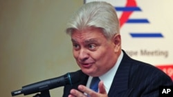Herve Ladsous, then French ambassador to China, gestures during a briefing with Serge Abou, the European Union ambassador to China [not pictured], in Beijing on October 16, 2008. (file photo)