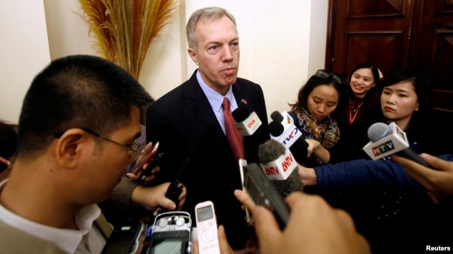 FILE - U.S. Ambassador to Vietnam, Ted Osius (C) speaks to the media at a bilateral conference at the Government Guesthouse in Hanoi.