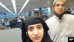 This July 27, 2014 photo provided by U.S. Customs and Border Protection shows Tashfeen Malik, left, and Syed Farook, as they passed through O'Hare International Airport in Chicago. The husband and wife died on Dec. 2, 2015, in a gun battle with authorities several hours after their assault on a gathering of Farook's colleagues in San Bernardino, Calif.
