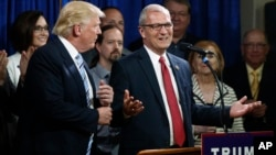 FILE - U.S. Rep. Kevin Cramer, R-N.D., right, talks about being one of the first to endorse then Republican presidential candidate Donald Trump during the North Dakota Republican National Convention in Bismarck, May 26, 2016.