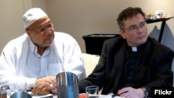 Imam Daayiee Abdullah and the Reverend Dwayne Johnson, shown in 2014, discuss LGBT rights in the U.S. and how to reconcile them with religious beliefs. (Photo via Flickr user East-West Center via Creative Commons license)