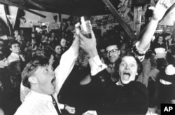 In this Wednesday March 2, 1989 file photo, Icelanders celebrate in a Reykjavik bar, as the first legal beer since 1915 went on sale in the Icelandic capital, which was banned following a referendum.