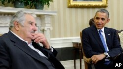 President Barack Obama listens to Uruguay's President Jose Mujica during a press availability in the Oval Office of the White House in Washington, Monday, May 12, 2014. (AP Photo)