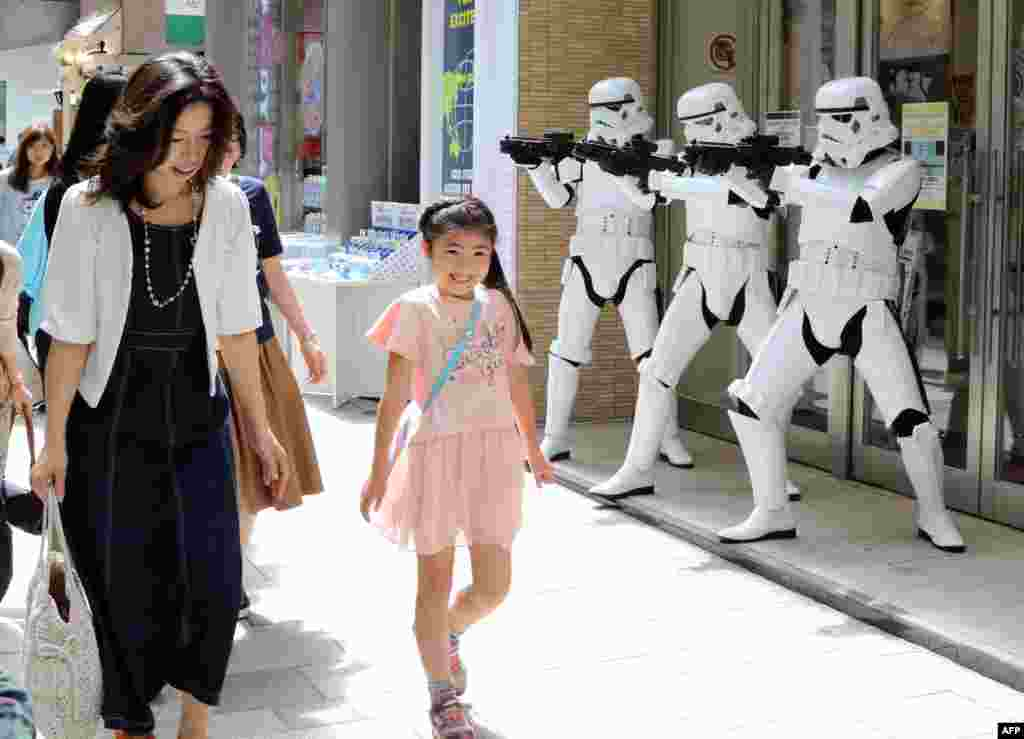 "Pedestrians pass before Storm Troopers at a toy shop in Tokyo. May 4th is called the ""Star Wars Day"" among Star Wars fans as the famous phrase ""May the Force be with you"" in the movie sounds like ""May the 4th be with you."""