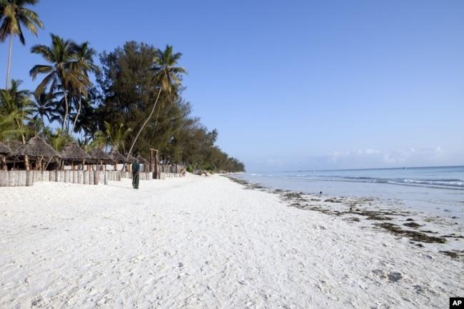 A villager walks along a deserted beach near a seaside resort on the East African archipelago of Zanzibar, Oct. 12, 2010.